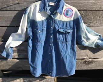 Bleached blue jean shirt with Girl Scout badge