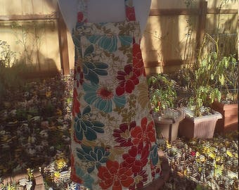 fall floral design on a cotton duck apron with a breast pocket and a large divided pocket in orange rust olive and teal fits up to 2xl