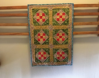 Original 6 square wallhanging with detailed centered flowers.