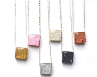 Eco friendly square pendant necklace made from reclaimed wood.