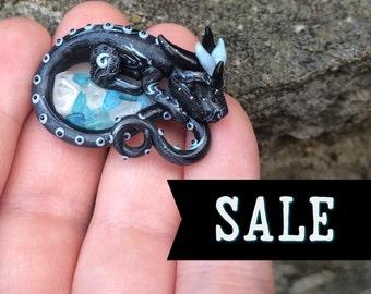 SALE: Asher, miniature sleepy black & blue polymer clay dragon with blue topaz, clear quartz stones handmade by Allison Muldoon/ChuckandStan