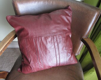 "Handmade one of a kind upcycled burgundy leather cushion / pillow with clay pipe tag. 16"" / 40cm  (Ref burg back panel)"