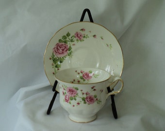 Vintage Avon tea cup Pink Roses Fine Bone China Made In England