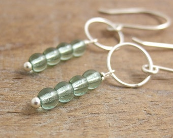 Earrings with a Sterling Silver Loop and Pale Green Glass Beads