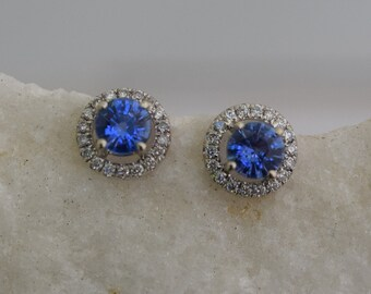 Blue sapphire studs. Stud earrings. White gold earrings. Blue sapphire diamond earrings. Halo studs. 14k white gold earrings Eidelprecious.