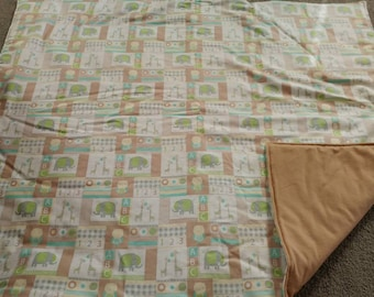 ABC blanket in greens and tans.