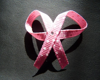 Pink bow with Ribbon decorated with polka dots