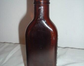 EARLY 1900s vintage father johns glass medicane bottle