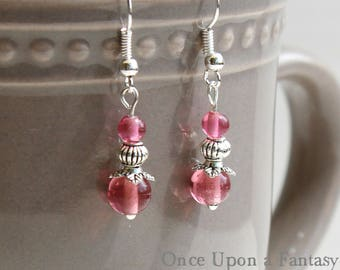 Earrings are pink pearls - Once Upon a Fantasy