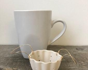 Passoire à thé en porcelaine