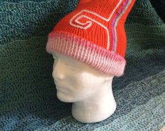 Double thickness reversible knitted hat with meander detail