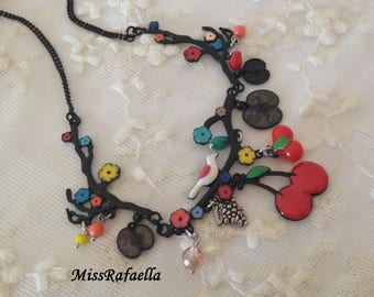 Red fruit necklace.