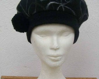 Black Fleece beret adorned with a tassel.