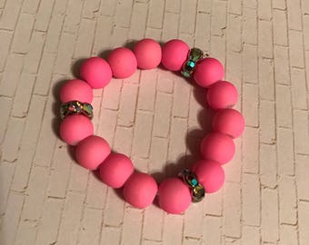 Matte pink and colorful pieces