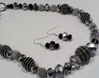Silver & black beaded necklace and earring set.