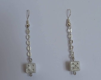 Dangling earrings with white dice