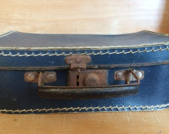 Old blue suitcase for children, with steel shoes
