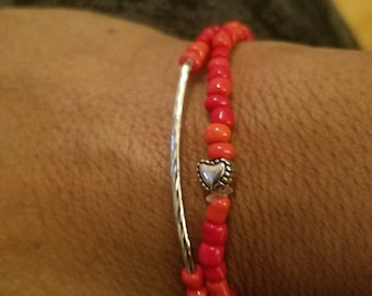 red seed beaded stretch bracelet set of 2