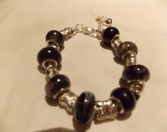 Hand made one of a kind  bracelet Black lamp works beads