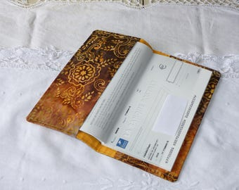 Checkbook holder in light brown, yellow batik fabric ochre