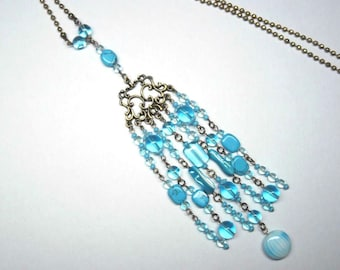 Necklace necklace glass beads and turquoise howlite, string and print bronze - coloured Collection