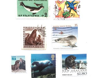 7 x Seal and Sea Lion postage stamps from 7 countries off paper, all different - Seals - for collage, stamp collecting, decoupage, mail art