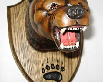Grizzly bear - the medallion trophy hunter. Handmade, wood carving.
