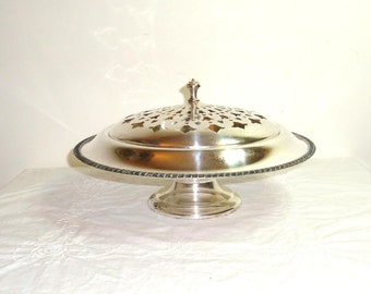 Silver plated footed serving dish with a pierced lid. Crescent  Silver Co. marked SPNS # 3159 in very good used condition.