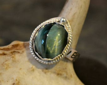 """Sterling silver ring with antique Green Tiger Eye stone.  Hand stamped band """"Never Say Never""""  size 6.5"""