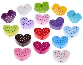 """The bead in lime green """"heart"""" pattern with dots"""