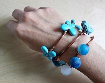 Rigid copper bracelet with magnesite butterflies