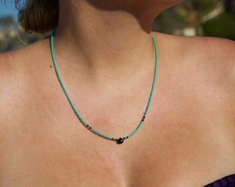 Black spinel teardrop pendant necklace with teal and gold beads