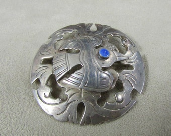 Sterling Silver Bird with Blue Stone Eye Pin