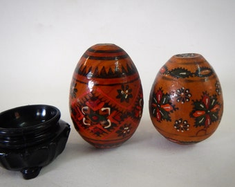 Two Hand painted Wooden Eggs and a stand