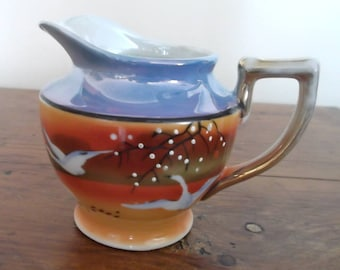 TAKITO...T & T Lustrewear Creamer....1940s....Handpainted...Made in Japan....Orange and Blue...White Cranes in Flight
