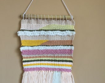 Woven wall hanging in spring colors
