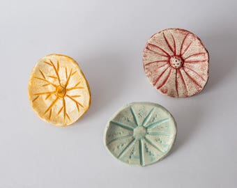 ceramic 3 flowers to put on studs, original by their different patterns, green, red, orange