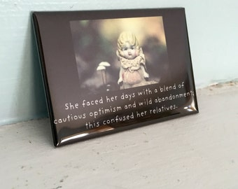 "Refrigerator Magnet Claudia Porcelain Bisque Doll ""Faced Her Days With a Blend of Cautious Optimism"" Typographic Art"
