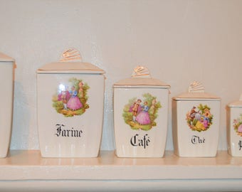 Set of six vintage French pottery cannisters.