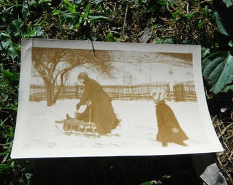 Vintage Snapshot Photo - Mother and Children Sledding in Snow