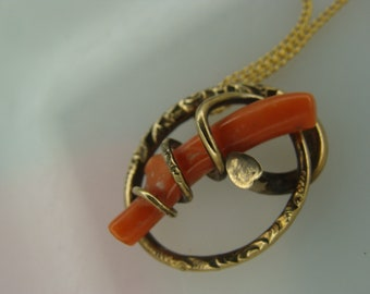 Vintage (late 1800) pendant, with a branch of raw coral.