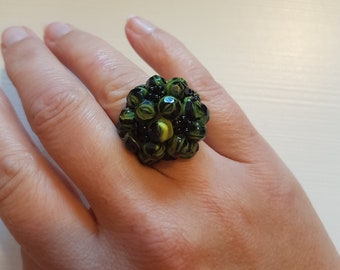 Green and black statement ring