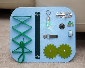 Busy Board. Activity board, early development Montessori educational toy.
