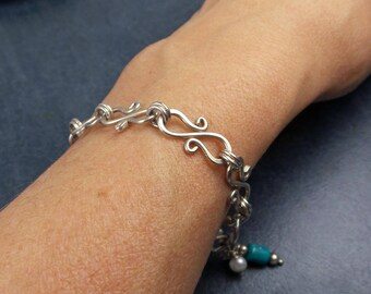Swirled Sterling Silver Bracelet, turquoise and pearl charms