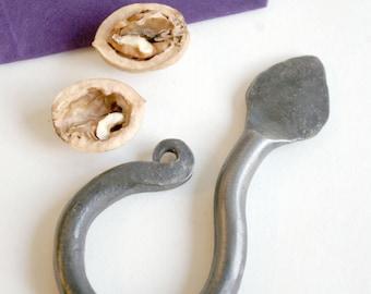 Hand forged walnut key nut cracker