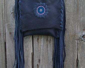 Navy blue leather handbag with a beaded starburst mandala