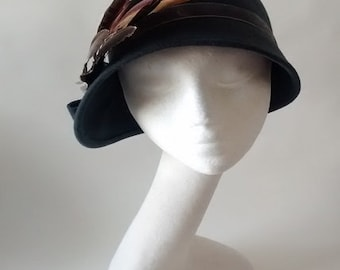 asymmetric brim cloche hat charcoal wool felt with natural feathers