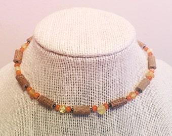 13 inch orange beaded hazelwood necklace with yellow amber