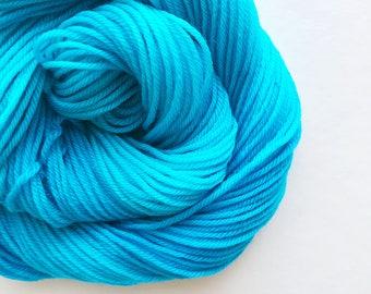 REEF hand dyed yarn fingering sock dk bulky yarn super wash merino wool yarn single or ply. choose your base. light turquoise blue yarn