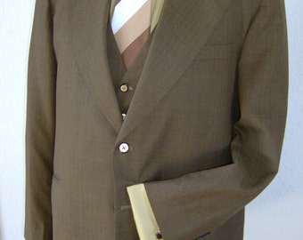 25% off  Bronze 3pc Suit by Ross Wellworth, Inc.  Dry cleaning is included in price.
